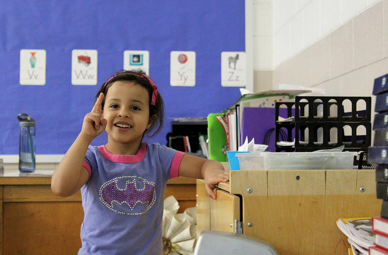 Kindergartener Maram Alhamadah sings an alphabet song at Nahed Chapman New American Academy, one of two programs dedicated to English-language learners at St. Louis Public Schools.