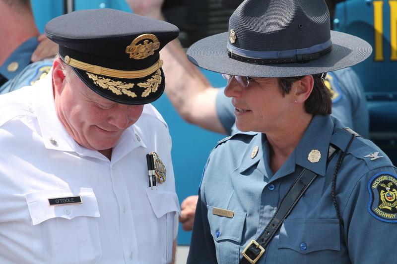 Missouri Highway Patrol Superintendent Sandra Karsten speaks with interim St. Louis Police Chief Larry O'Toole in July. The Highway Patrol began monitoring St. Louis highways this summer.