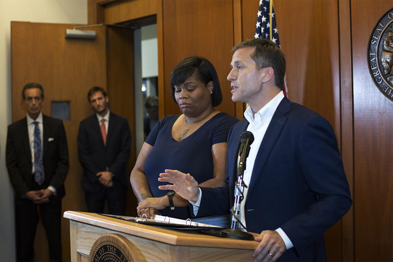 Gov. Eric Greitens speaks at a news conference Thursday night alongside Christina Wilson, the fiancee of Anthony Lamar Smith.