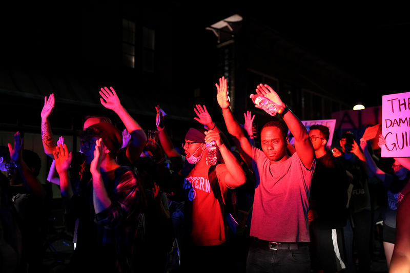 Protesters march through the Central West End on Friday night.
