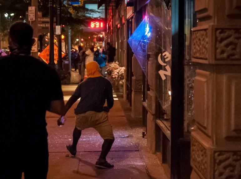 Bits of glass covers a sidewalk in downtown St. Louis after people broke windows on Sunday. (Sept. 17, 2017_