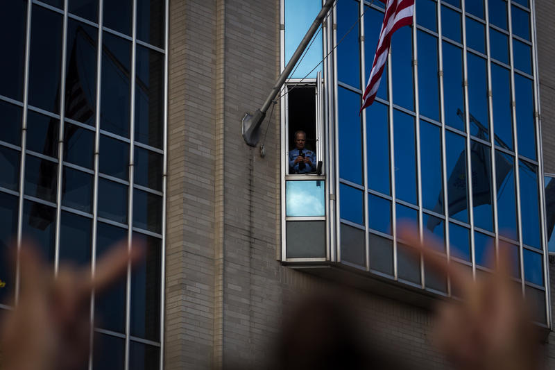 A demonstrator shows her displeasure toward St. Louis Metropolitan Police headquarters Sunday, Sept. 17, 2017 during protests over the acquittal of a white city police officer on murder charges.