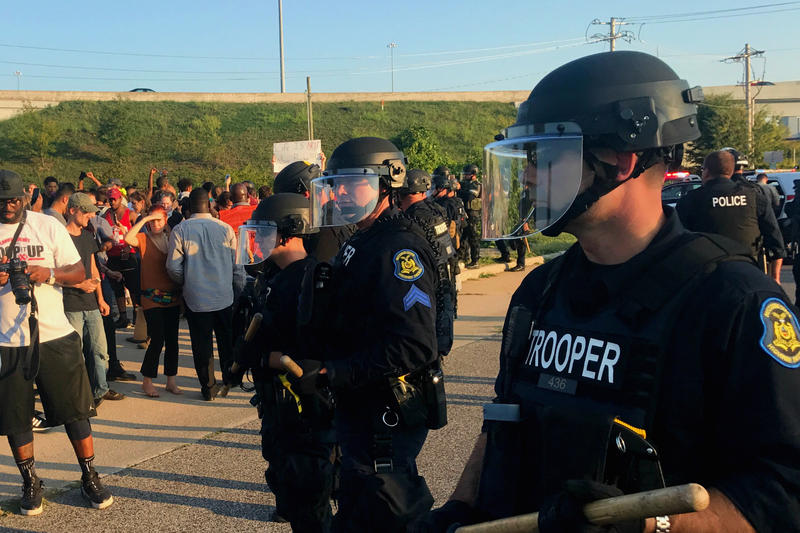As protesters walked on Brentwood Boulevard, police in riot gear protected blocked the ramp to Interstate 64.