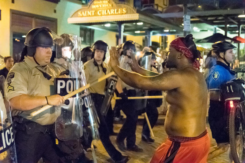 Police briefly clashed with a few demonstrators toward the end of a protest in downtown St. Charles Friday night.