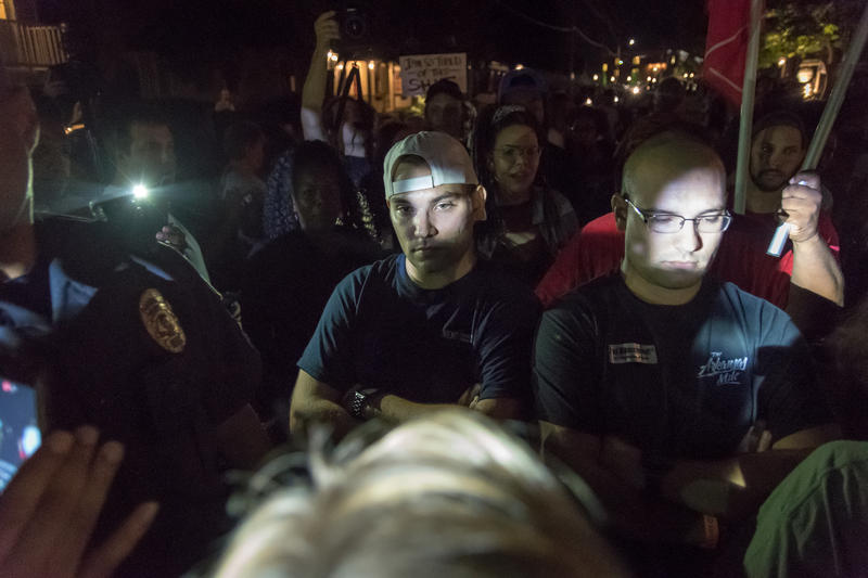 Two men confront a crowd of demonstrators during a protest Friday night in St. Charles. It was the eighth day of protests following the not-guilty verdict of white ex-St. Louis police officer Jason Stockley on first-degree murder charges.