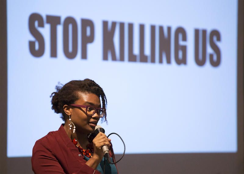 "Michelle Higgins clarifies protesters' main demand – ""stop killing us"" – at the People's Town Hall at Christ Church Cathedral in downtown St. Louis. Sept. 28, 2017"