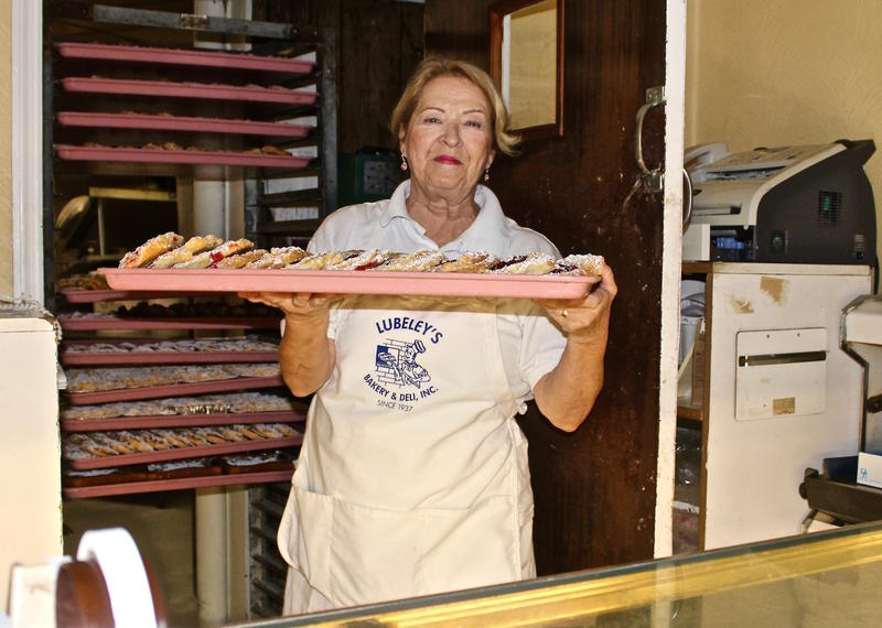 Helen Lubeley Murray fills the display cases at Lubeley's Bakery Thursday morning.