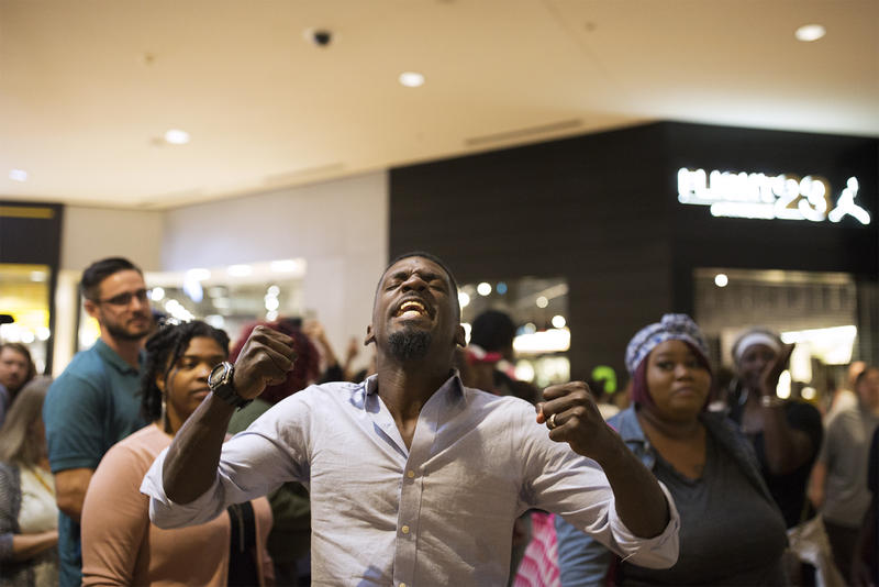 State Rep. Bruce Franks Jr. leads a chant inside the St. Louis Galleria. Sept. 30, 2017.