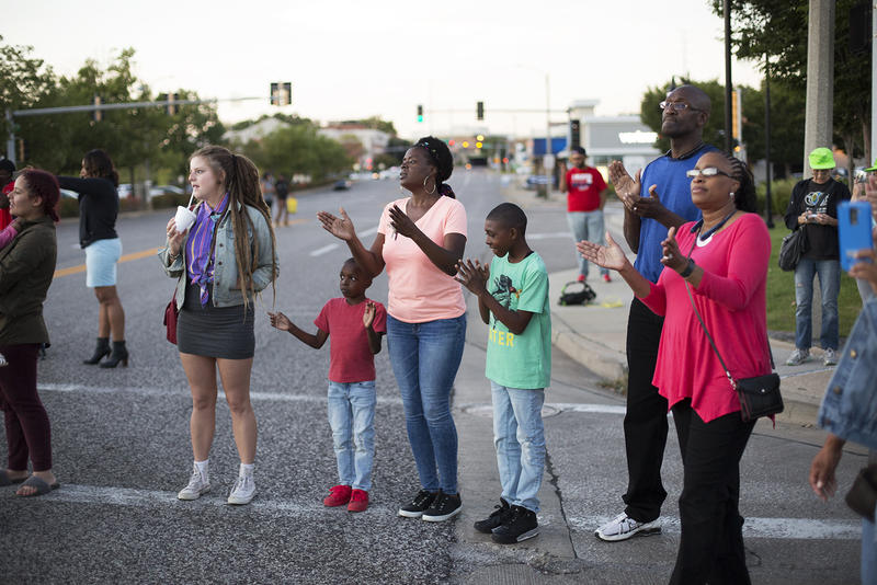 Protesters stand at the intersection of Brentwood Blvd. and Galleria Parkway. Sept. 30, 2017