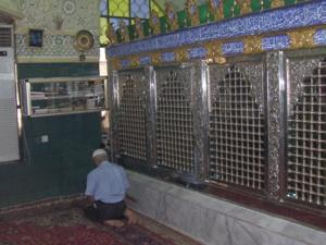 An old man prayed in one corner by Korans on a shelf. Suleimanya Iraq