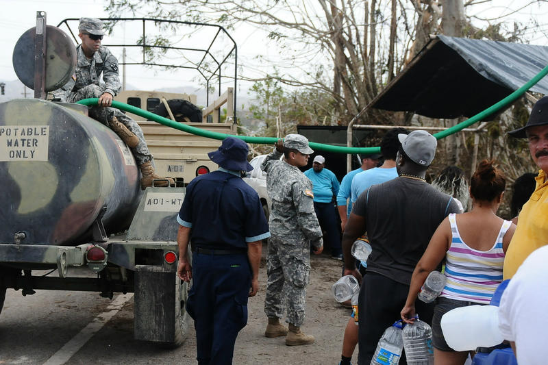 Puerto Rico National Guard members distributed water to the communities of Utuado, Puerto Rico, in late September.