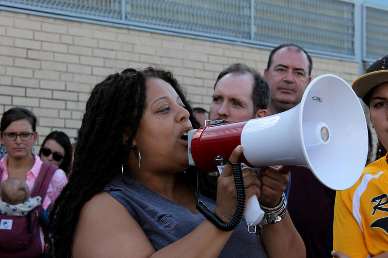 Alice Prince, the director of the St. Louis Agency on Training and Employment, tells protesters how people can connect to jobs at her agency Oct. 1, 2017.