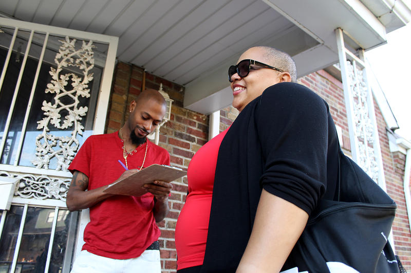 Protester Nicole Greer helps Penrose resident Antoine Jones register to vote Oct. 1, 2017 in St. Louis.