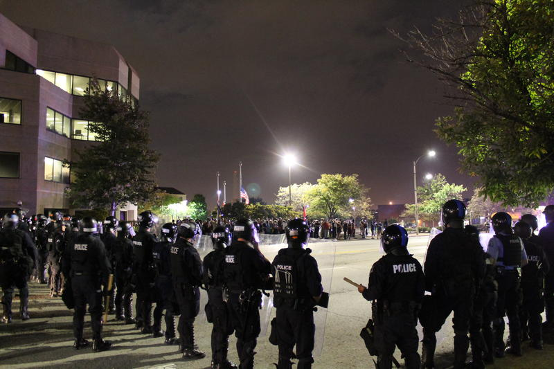 Police officers form a line near Jefferson Avenue and Market Street. Dozens of people were arrested after blocking Interstate 64 on Oct. 3, 2017.