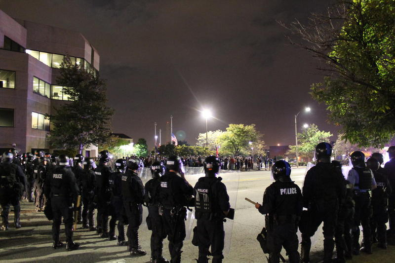Police officers form a line near Jefferson Avenue and Market Street. Dozens of people were arrested after blocking Interstate 64 on Tuesday.