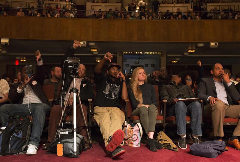 Audience members turn thumbs down to St. Loius Mayor Lyda Krewson. Oct. 11, 2017