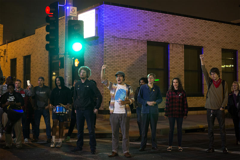 Protesters stand at the intersection of Olive Street and Compton Avenue Oct. 11, 2017