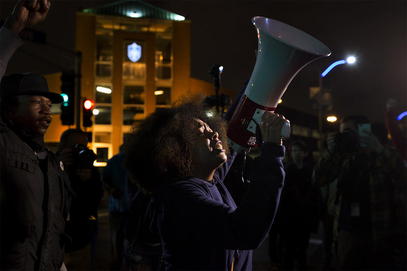 LaShell Eikerenkoetter leads a chant as protesters stand at the intersection of Olive and Compton following a forum at Harris-Stowe State University. Oct. 11, 2017