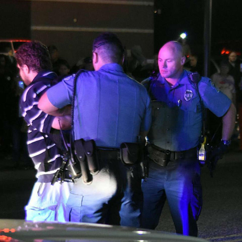 Ferguson police officers arrest a protester on Friday, Oct. 13, 2017