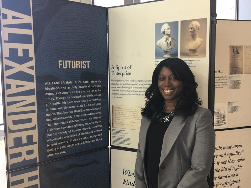 Stephanie Snow, a staff attorney with the U.S. Court of Appeals for the Eighth Circuit, standing in front of one of the panels that's part of an exhibit about Alexander Hamilton.