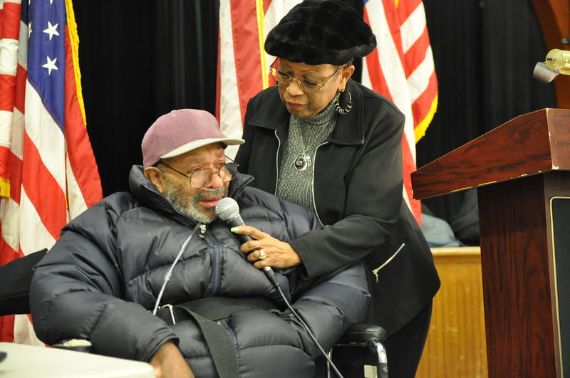 Veterans Home resident Curtis Washington, who served during the Korean War, shares his concerns. His wife Sandra holds the microphone.