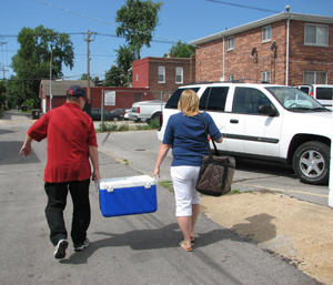 Volunteers pack up meals to be delivered to seniors at the Carondelet Senior Center in south St. Louis. 2008. 200 pixels