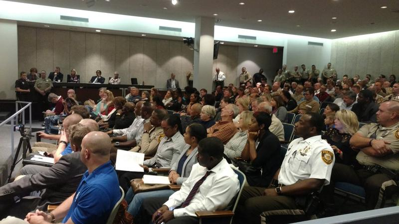 County police and their families help pack the room as the County Council considers a police pay raise.