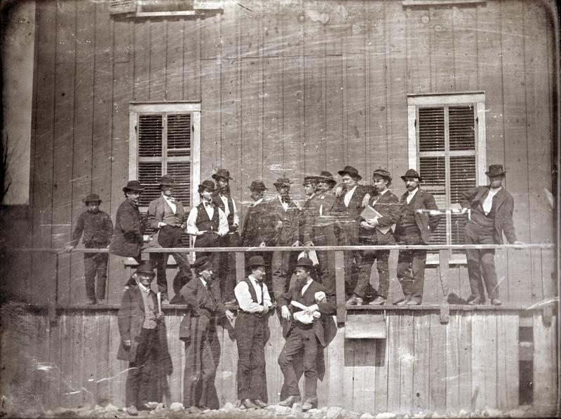 Men outside of Lynch's slave pen, 1850s. One of these men might be Lynch himself, but there are no known photos of him.