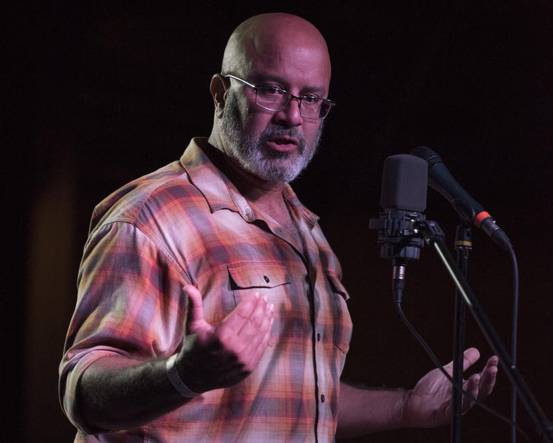 Saint Louis University biologist Gerardo Camilo telling a story live on stage at The Story Collider event at The Ready Room on Oct. 5, 2017.