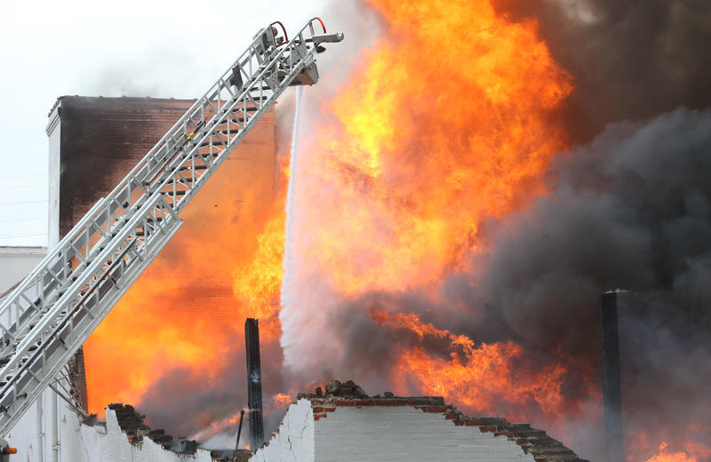 A fire rages out of control in a warehouse after walls collapsed during a five-alarm fire in St. Louis last Wednesday. Nearly 200 St. Louis firefighters battled the warehouse containing numerous paper products and nearly 200,000 candles.
