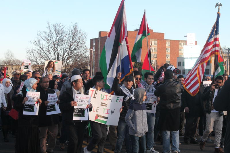 Protesters march down the Delmar Loop Sunday denouncing President Donald Trump's decision to recognize Jerusalem as the capital of Israel. (Dec. 10, 2017)