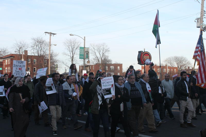 Protesters marched down the Delmar Loop denouncing President Trump's decision to recognize Jerusalem as the capital of Israel.