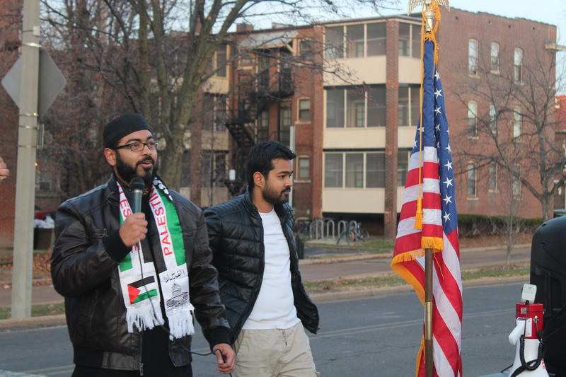Faizan Syed, executive director for the Missouri chapter of the Council on American-Islamic Relations speaks to protesters after the march Sunday. (Dec. 10, 2017)
