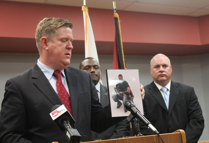 St. Clair County state's attorney Brendan Kelly holds a photo of Quiantez Fair, who was killed in East St. Louis in October. Kelly and law enforcement officials are asking people to help them solve the murder of Fair and 25 other people in the city.