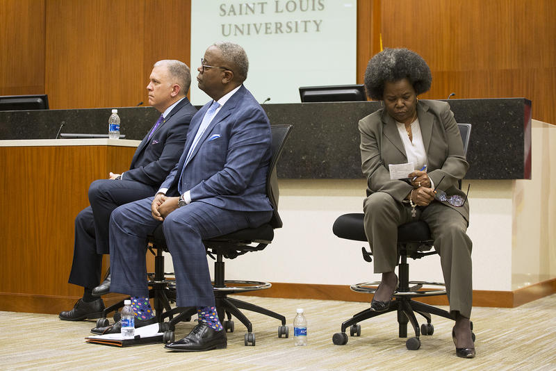 Maj. Stephen Max Geron of the Dallas Police Department, Police Chief Keith L. Humphrey, of Norman, Oklahoma and Capt. Mary Edwards-Fears, currently assigned to the St. Louis police department's the Bureau of Professional Standards, wait to answer question
