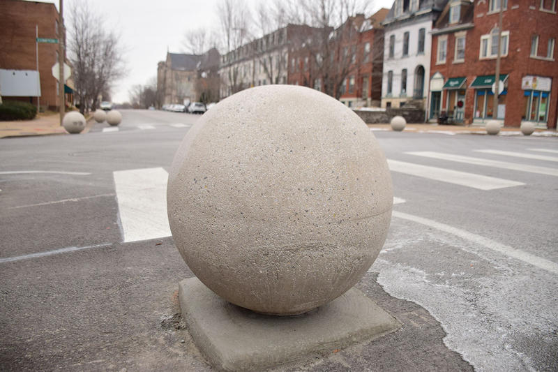 At each of six intersections along Compton Avenue in south St. Louis, 16 of these balls now sit in the road, narrowing lanes.