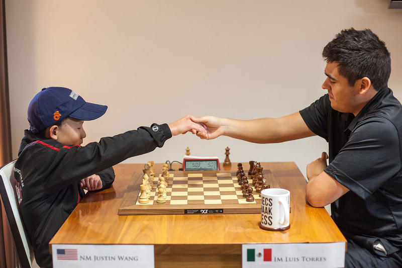 Justin Wang (left), playing against Luis Torres. Wang, 12, was the youngest player in the event and achieved his first international master norm. 2017