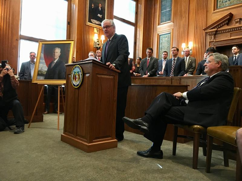 Former Gov. Jay Nixon stands next to his official portrait last week in Jefferson City. (January 2018)