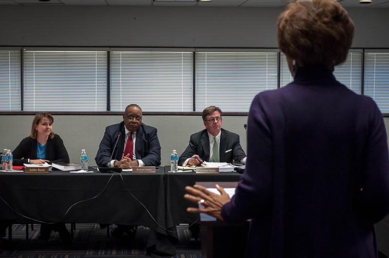 Addie Bond, a St. Louis parent, Special Administrative Board member Richard Gaines and legal counsel Jonathan Dalton listen to a presentation during a governance task force meeting Wednesday, Jan. 17, 2018.