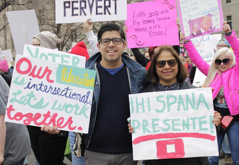 Pedro Guerrero with his mom, Elizabeth Guerrero, march in the St. Louis Women's March for Truth on Saturday, Jan. 20.
