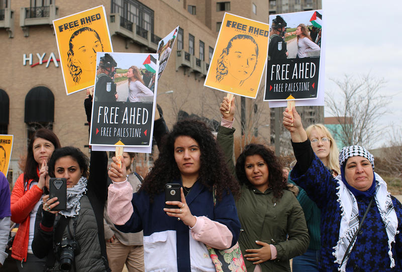Marchers listen to Palestinian-American activist Sandra Tamari's speech calling for the release of 16-year-old Ahed Tamimi from Israeli military prison.