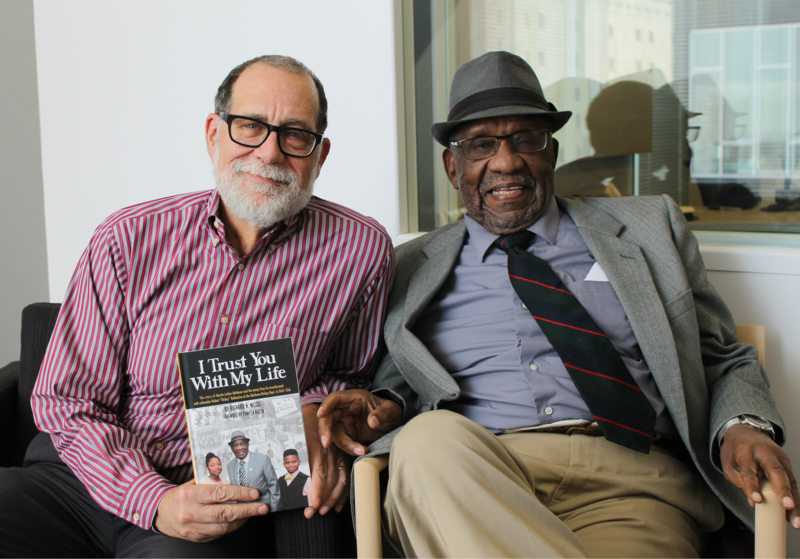 Richard Weiss (left) and Martin Luther Mathews (right) talked about the history of the Mathews-Dickey Boys' and Girls' Club and the book that details it.