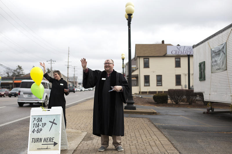 The Rev. Jim Peich waves to drivers on Manchester Road. Feb. 14, 2018