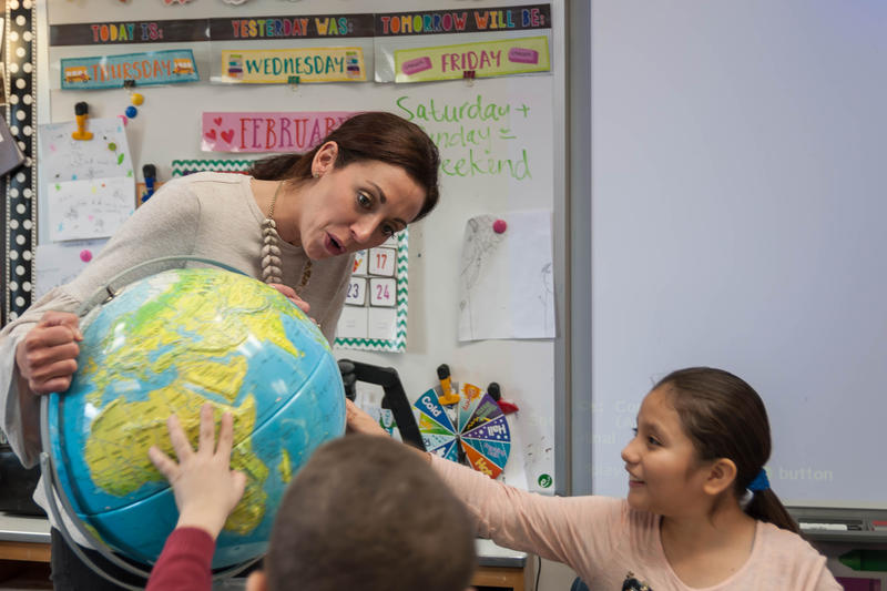 Sasha Walchli, an English language teacher at Parkway's Green Trails Elementary, works with third-graders on learning continents. Walchi has 43 students at the school, twice as many as when she started 10 years ago.