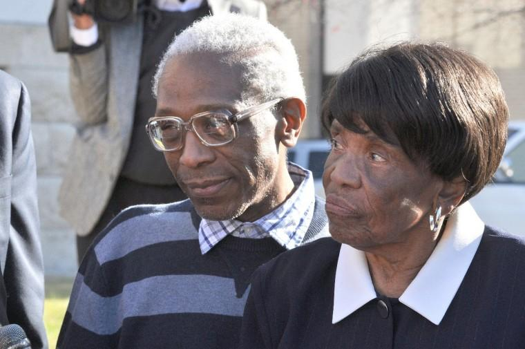George Allen and his mother Lonzetta Taylor speak to reporters on Nov. 14, 2012 after a judge threw out Allen's 1983 conviction for rape and murder. His family has settled a federal civil rights lawsuit for $14 million.