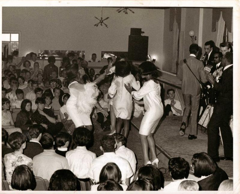 Club Imperial guests watch Tina Turner dance while Ike Turner performs on stage in the 1960s.