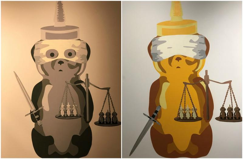 Injustice Bear is the title of the black-and-white piece; Justice Bear is the name of the gold and yellow work. A street artist known as finnch created the contrasting canvasses.