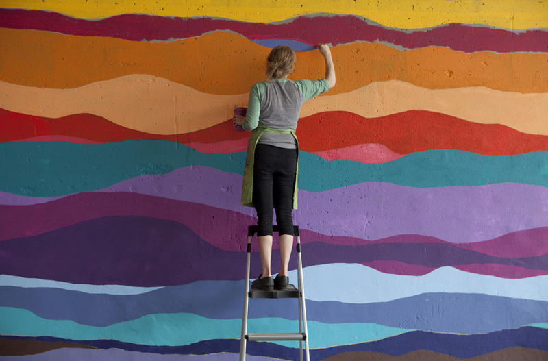 Visual artist and RAC grantee Ellie Balk works on a mural. She hopes to use some of her RAC fellowship money to create a workbook to demystify the process of creating public art.
