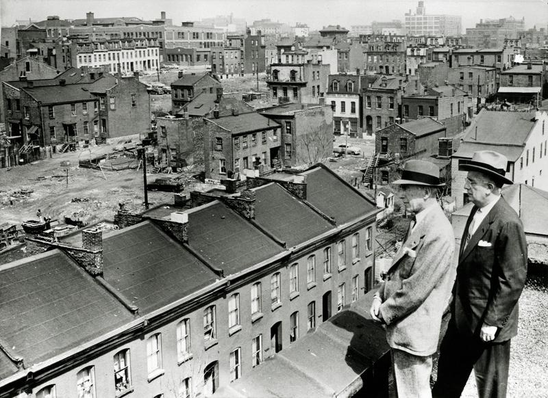 Former Mayor Raymond Tucker (at right) and then-civic leader and bond issue chairman Sidney Maestre look out over an area of Mill Creek Valley slated for clearance in this photograph from 1956.