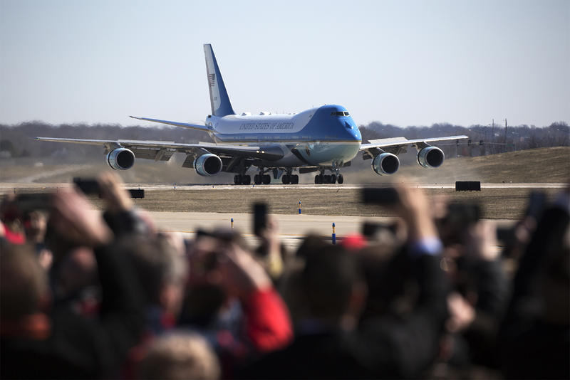 Onlookers watch as Air Force One lands at St. Louis Lambert International Airport in March 2018.